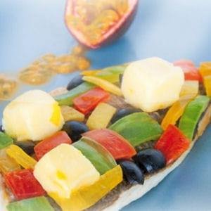 filet de dorade royale et sa mosaïque de légumes, arrosée de passion glacée