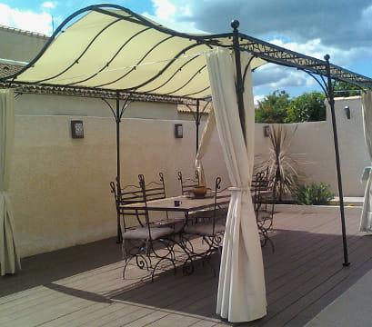 Terrasse couverte fer forge for Pergola en fer forge pour terrasse