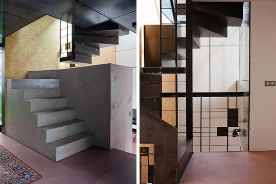un double escalier central une maison de ville ouverte. Black Bedroom Furniture Sets. Home Design Ideas